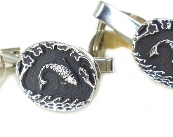Silver & black fish cufflink tie bar set. Detailed scales and relief scene set antiqued silver. Elegant textured backside.