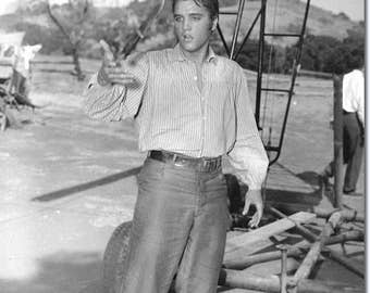 Elvis Presley on the set of Love Me Tender in 1956 .