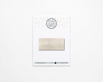 Platinum leather snap clip