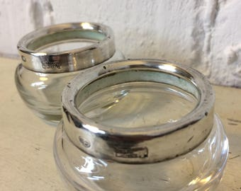 A Pair Of Sterling Silver Glass Open Salt And Pepper Dishes