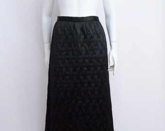 Black quilted maxi skirt size small.