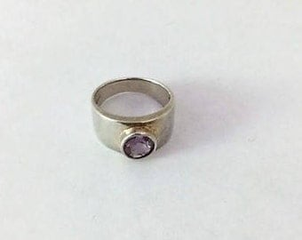 SILVER TOPAZ RING. Sparkling pale pink topaz, bezel set in a wide sterling band. Very pretty  Size 7-1/2. Gift box included.