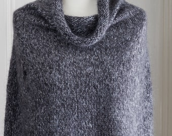 This cape is 'The Supersized Hug' - a super soft and warm capelet or poncho, hand knit with a super kid mohair & silk yarn in dark grey