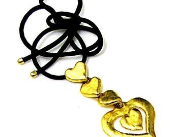 YVES ST LAURENT, thinking better vintage gold metal pendant