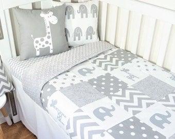 Monochrome grey elephant and giraffe patchwork nursery set items