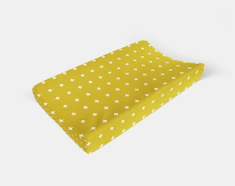 Changing Pad Cover Mustard Plus. Cross Change Pad. Plus Sign Changing Pad. Mustard Changing Pad. Baby Bedding.