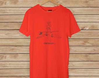 Surfer T-shirt - Decisions - Which board should I take out today? My short board? Long board? Available in 5 colors, 100% Pre-Shrunk Cotton