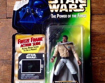 1997 Lando Calrissian in General's Gear, Star Wars, Power of the Force Action Figure. Cared and Factory Sealed. Kenner (Hasbro Inc).