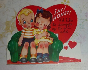 Boy and Girl Snuggling on a Sofa - Vintage A-meri-card Valentine