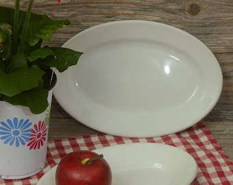 VINTAGE IRONSTONE PLATTERS; Two small white oval platters