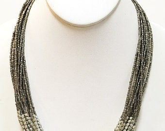 Silver and Dark Silver Multi Strand Beaded Necklace.