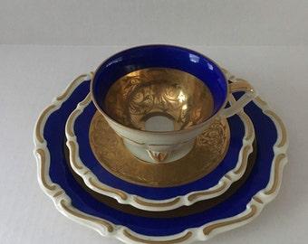 Al-Ka-Kunst Teacup With Quadrefoil Foot, Saucer and Dessert Plate
