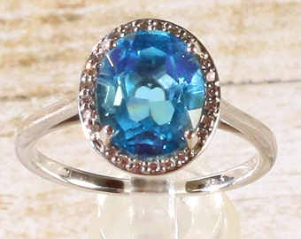 14K White Gold Diamond Swiss Blue Topaz Halo Style Engagement Ring 6.5, Set with a 2.5 Carat or 10x8 MM Oval Topaz Gemstone