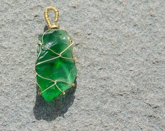 Green glass, wire wrapped pendant