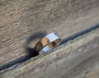 Beautiful handmade solid .999 fine silver ring, hand forged and hammered. Adorable little thing, it's a US women's size 5.5