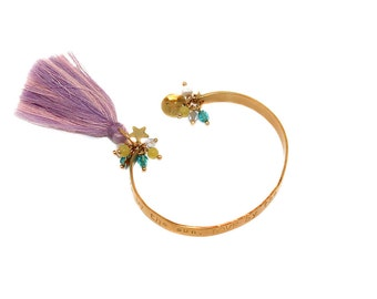 Lyrique - hand stamped brass cuffs with cotton tassel, bead and crystal embellishments