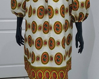 African print off shoulder dress.
