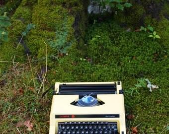 Yellow Olympia typewriter