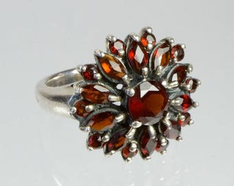 Stylish 1950s vintage garnet and silver cluster ring.