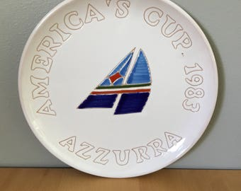 Fantastic vintage commemorative plate from the America's Cup sailing event Azzurra Italy 1983 featuring fun blue red  & green sailboat!