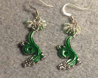 Green enamel dragon charm earrings adorned with tiny dangling green and clear Chinese crystal beads.