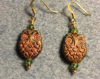 Olive green with copper wash Czech glass owl bead earrings adorned with olive green Chinese crystal beads.