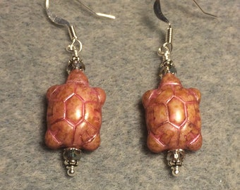 Pink alabaster travertine Czech glass turtle bead earrings adorned with pink Chinese crystal beads.