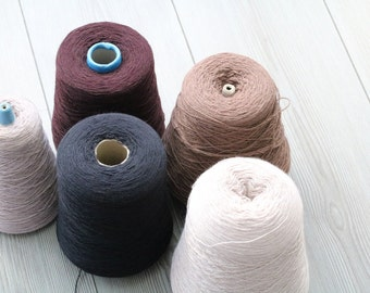 Set of five lambswool yarns,yarns on cone,weaving,knitting,machine knitting,textiles,fibre crochet,knitting yarn.