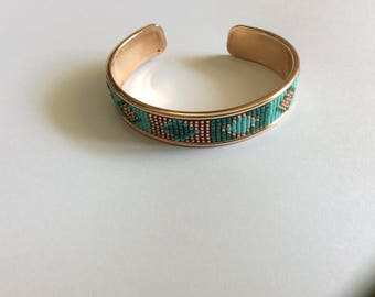 DQ metal bracelet with miyuki delica beads.