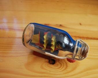 Ship  Ship in a bottle Miniature ship Vintage ship in a bottle Nautical decr  Vintage souvenir  Glass bottle  Ship