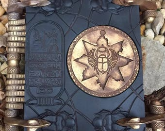 Mummy Book of the dead with Keys and scarabs (book does open)