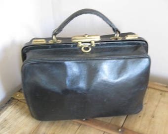 French vintage small black leather doctor bag.