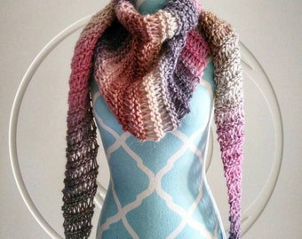 Multicolored triangular scarf with PomPoms finishes. Sana.
