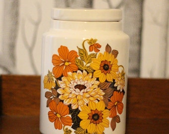 1970s orange floral storage jar
