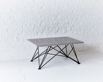 Polished concrete coffee table with powder coated mild steel legs