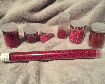 Seven (7) vials of Red Seed Beeds Assorted sizes