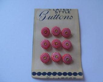 Vintage plastic buttons on original card. Plastic flower buttons. A set of Nine vintage buttons.
