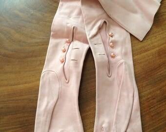 1 pair pink suede elbow length 1950's gloves. Medium.