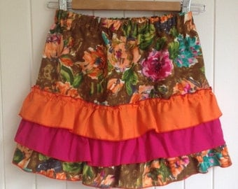 Size 10 Girls Skirt in mix of hot pink and oranges with bottom frills