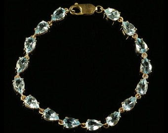 Blue Topaz 9ct Yellow Gold Bracelet Over 12ct of Topaz