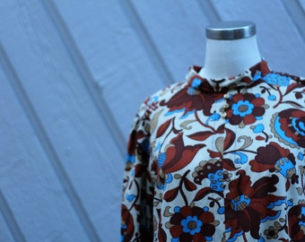1960s Retro Powder Blue Floral and Paisley Shift Dress with Quarter Sleeves and Gold Buttons at the Neckline