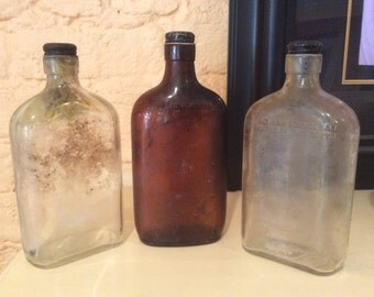 Set of Three Vintage Whiskey Bottles - 2 clear glass 1 brown