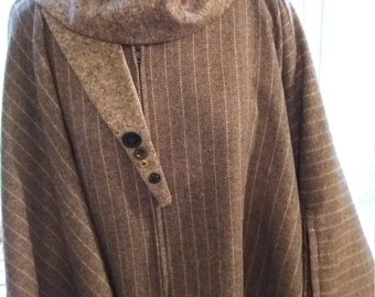 Tweed Cape fully lined in contrasting fleece with front center zip fastening, super warm and very stylish