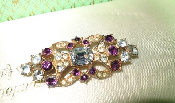 Vintage 1950s Hollywood clear and purple rhinestone goldtone  brooch
