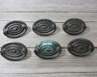 Set of six vintage metal drawer pulls. Elegant metal drawer pull