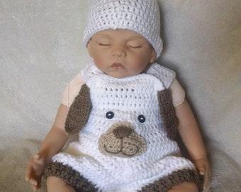 Crochet puppy overalls.