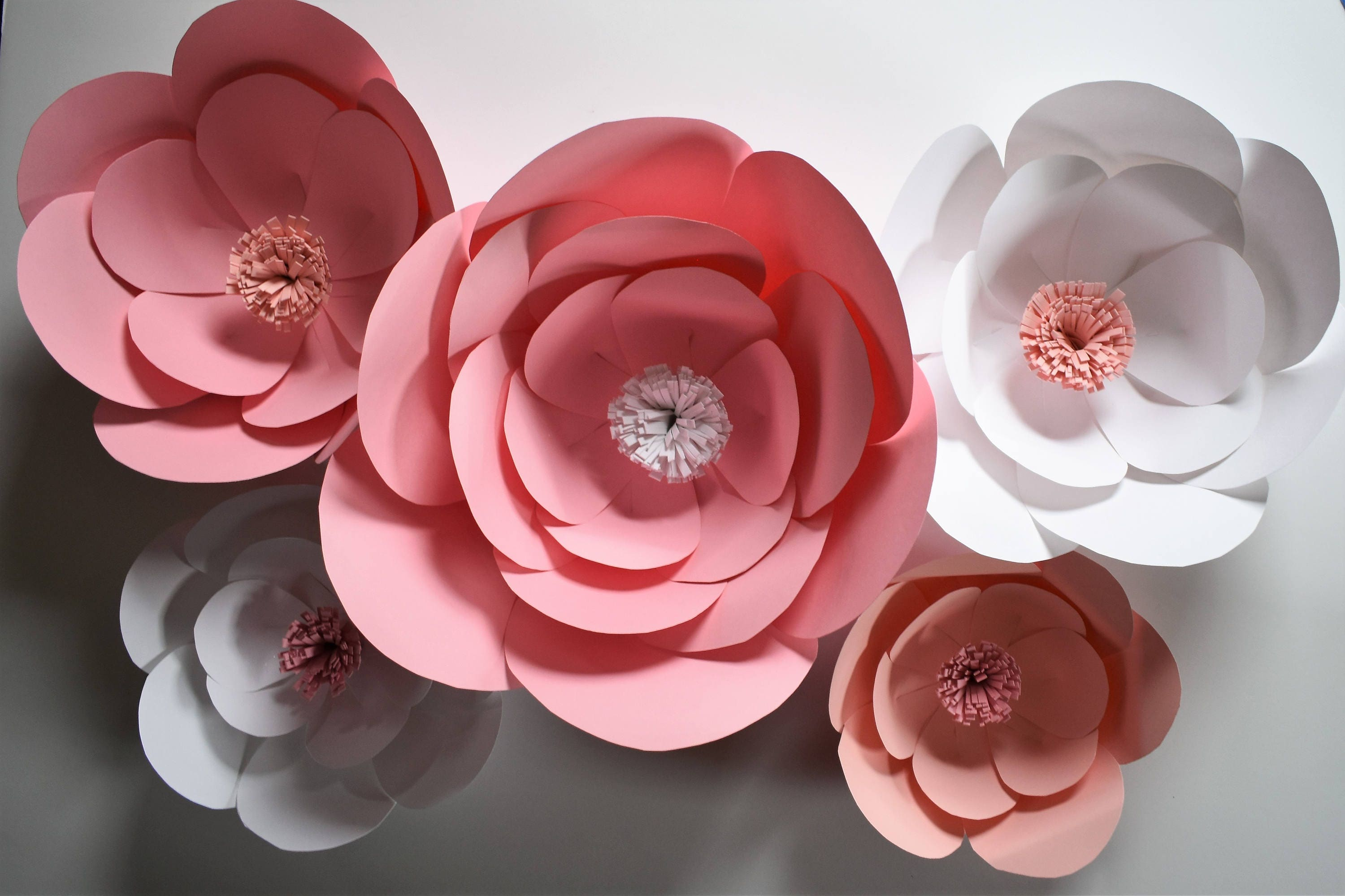 Large pink paper flowers pink baby shower decor for Baby shower flower decoration