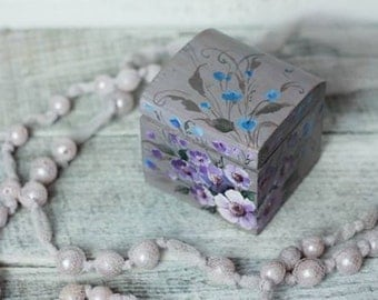 A very, very small box. Wooden, box, casket with flowers
