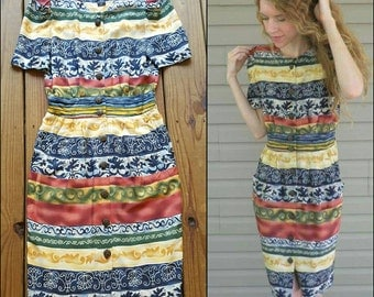 Vintage 90's Positive Attitude size 6 petites S - XS fitted button up dress in reds, blues, and golds. Patterned horizontal stripes