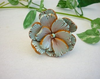 Flower ring , light blue and gilded lines, polymer clay